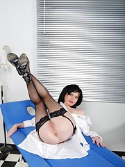 Sexy babe in black stockings seducing handsome doctor