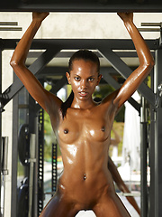Young oiled black body needs to have a full workout