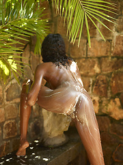 Nude ebony teenie girl takes a outdoor shower