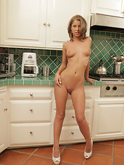 Naughty babe Presley Hart pleasures her pussy with a sex toy in the kitchen