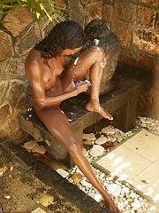 Super skinny ebony girl shaving her bronzed legs and pussy