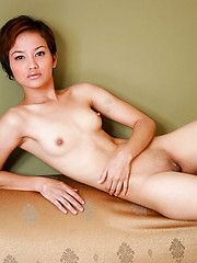Lovely thai girl in the sofa spreading her shaved pussy