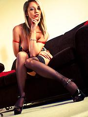Nikki wears black stockings and sexy dress