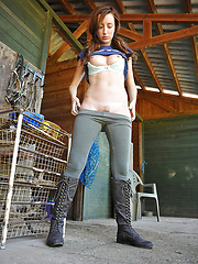 Equestrian girl takes off her tight grey leggings