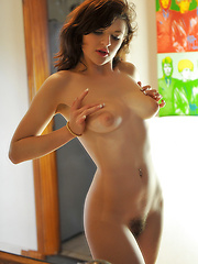 Young model shows her hairy pussy
