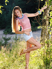 Amidst the wild grass,and the budding bushes, Sofy showcases her natural beauty with engagingly carefree poses that reminds us of lazy summer afternoons.