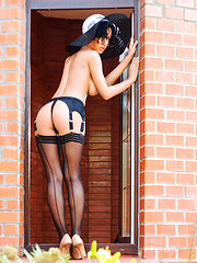With the bright sun shine, Pammie Lee sensually strips off her deep elegant black lingerie, hot sexy stockings and poses with so much ease outside the garden bench.
