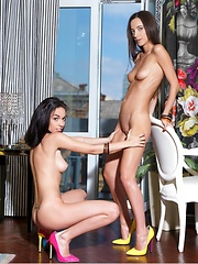 Two lusty and arousing blonde in an erotic girl-on-girl action, exploring each other\'s aroused body on top of the bed.