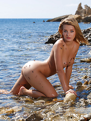 With a confident, youthful allure, Edwidge is a stunning sight as she strips her smoking hot see-through dress amidst the sandy, rocky beach shore and calm sea breeze.