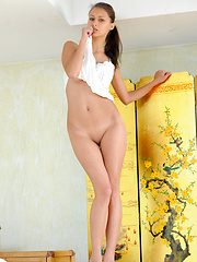 Charming but naughty Yarina hastily strips her white night dress to reveal her slender but nubile figure, with delicately tight assets that can set your hearts racing.