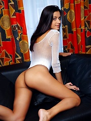 Belinda, whose sweet yet naughty looks can lure you into sensual adventures, showcases her magnificently body while stripping her lingerie and see through shirt in front of the camera.