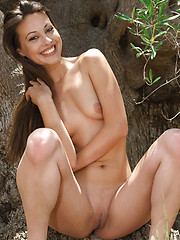 Sweet babe Lorena shows her trimmed pussy outside