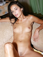 Olga has long legs , a bronze color on her skin, a set of rock hard abs and see through panties.