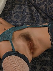 Baby-faced model in dainty lace lingerie and stockings.