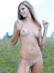 Tall blonde lean girl with pretty tan lines on her ass and breasts loves to run through the flowers.