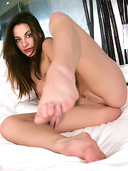 Big blue eyes and silky brown hair on this very sexy girl who has a set of pink lips that talk to your heart.