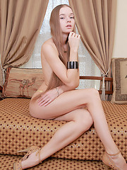 Milena petite package with delightfully pink and perky tits, untrimmed bush, and slender long legs, showcased in wide open poses.