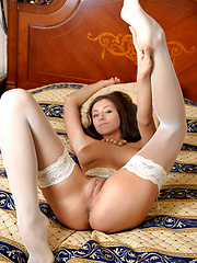 Well-looking girl in white stockings