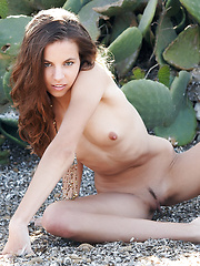Exotic brunette Altea show off her firm ass and petite breasts in this desert shoot.