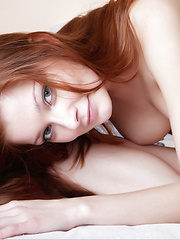 Tiny little red haired girl with white skin and creamy breasts and a beautiful body to boot.