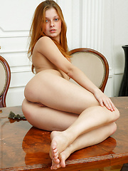 Slim red head with a hard ass and small perfect breasts really gives a table dance.