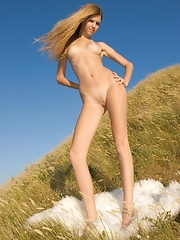 Long blonde hair on this tall pretty girl who goes naked in the sun and fields and shines like an angel.