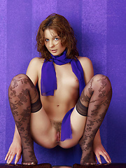 Flashy model with curly red hair has an exquisite body and big eyes that send their own messages.