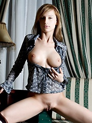 Voluptuous blonde with magnificent large breasts, pink nipples, and elegantly trimmed labia