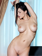 Jenya takes off her clothes and shows huge breasts