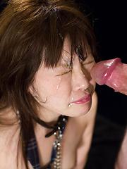 Asian beauty swallows hard cock