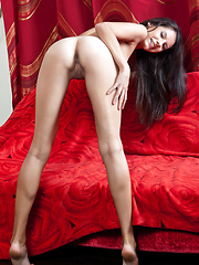 Swan makes sure her best assets, her gorgeous tanned body takes the limelight as she seductively poses in front of a fiery red background.