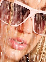 Glonde in bikini getting wet