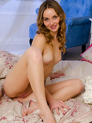 Adorable and charming Milagres with her endearing smile, youthful looks, and young, nubile body posing all over the bed.