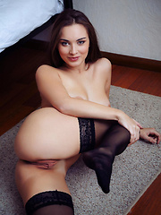 Natalie raises her sexy meaty legs to bare her smooth delectable pussy as she confidently showcase her gorgeous body on top of the bed.