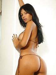 Karla Spice teases you in her tiny tan bikini