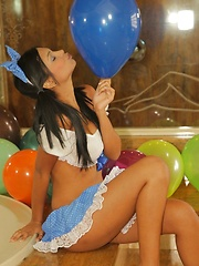 Karla Spice is dressed up like a doll and gets playful with balloons