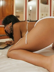 Karla Spice looks at her sexy mirrored image while relaxing in bed