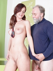 Nadya lifts up her blouse and her tits are licked and sucked by her older teacher.