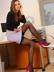 Secretary shows a sexy strip in her office.