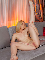 Lovely, lithe Lenny Mae is playful and loves to tease.  Look at her legs spread wide open showing off her lovely smooth labia.