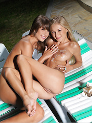Candice B and Mia D touch each other's bodies in the sun
