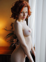 The charming redhead with the vivacious smile, porcelain skin, and absolutely beautiful body, Zarina A enjoys posing nude in front of the camera