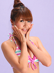 Hazuki Minami Asian in very colorful bath suit is so leering