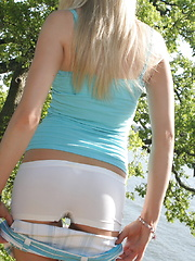 Cute teen Skye is by the lake as she shows off her perfect ass and teases with perky tits