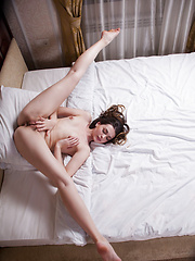 Lukki Lima shows off her body\'s flexibility as she spreads her legs wide open like a graceful gymnast