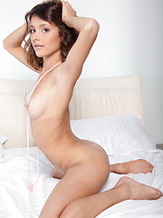 Divina A long and slender legs delightfully clad in sheer white stockings