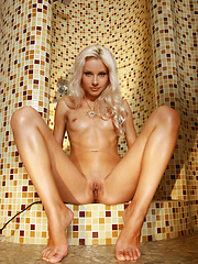 Ardelia poses sensually and cools down   her smoldering hot body with a cool   shower while maintaining her   irresistably seductive allure.