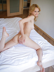 Wearing a sexy pink nightwear matching lingerie, Edita Recna poses enthusiastically on the bed showcasing her slender body with glowing pale skin and spreading her sexy legs, baring her smooth, pink pussy.