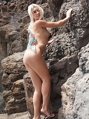 Cristina\'s delicate, slender body, undeniably pretty face, and refreshing personality is a pleasing break from the rugged rocks and desolate beach on her background.