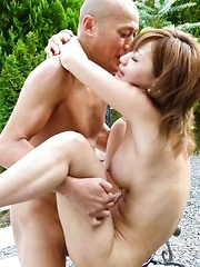 Aika Asian sucks phallus and rides it on bench in outdoor fuck
